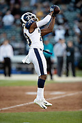 Los Angeles Rams defensive back Lamarcus Joyner (20) leaps and catches a pass during pregame warmups before the 2018 regular season week 1 NFL football game against the Oakland Raiders on Monday, Sept. 10, 2018 in Oakland, Calif. The Rams won the game 33-13. (©Paul Anthony Spinelli)