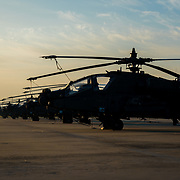 Apache Helicopters on line as the sun rises i Korea.