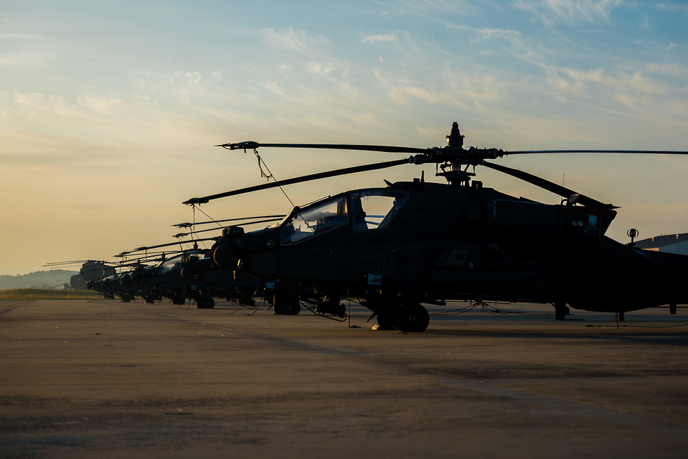 Apache Helicopters on line as the sun rises i Korea.