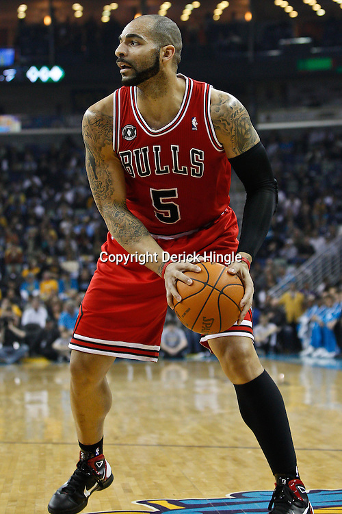 February 12, 2011; New Orleans, LA, USA; Chicago Bulls power forward Carlos Boozer (5) against the New Orleans Hornets during the first quarter at the New Orleans Arena.   Mandatory Credit: Derick E. Hingle