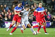 Jodie Taylor of England Womens (centre) hold off Lauren Holiday of USA Women (left) as Carli Lloyd of USA Women (right) looks on during the International Friendly match at stadium:mk, Milton Keynes<br /> Picture by David Horn/Focus Images Ltd +44 7545 970036<br /> 13/02/2015