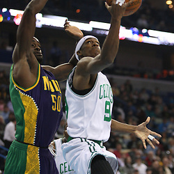 Feb 10, 2010; New Orleans, LA, USA; Boston Celtics guard Rajon Rondo (9) attempts a shot past New Orleans Hornets center Emeka Okafor (50) during the first quarter at the New Orleans Arena. Mandatory Credit: Derick E. Hingle-US PRESSWIRE