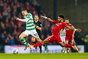 Shaleum Logan (#2) of Aberdeen slides in late on Callum McGregor (#42) of Celtic during the Betfred Cup Final between Celtic and Aberdeen at Celtic Park, Glasgow, Scotland on 2 December 2018.