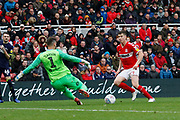 Middlesbrough midfielder Paddy McNair (17) has a shot saved by Derby County goalkeeper Scott Carson (1)  during the EFL Sky Bet Championship match between Middlesbrough and Derby County at the Riverside Stadium, Middlesbrough, England on 27 October 2018.