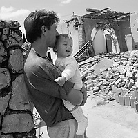 Father and son near their home that was destroyed during the war between Croatia and forces loyal to the former Yugoslavia.