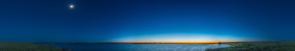 A 200&deg; panorama of the waxing gibbous (8-day-old) Moon in the spring evening twilight over Lake MacGregor in southern Alberta, on June 2, 2017. The Sun has set to the northwest at right and the Moon shines in the west. To the left of the Moon is Jupiter and Spica.<br /> <br /> Shot from the east shore of the lake, with a 24mm lens in 8 segments, and stitched with PTGui.