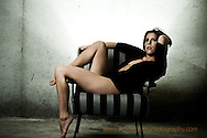 Model in lingerie sitting in chair, Lees Summit Missouri