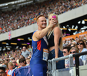 Greg Rutherford takes selfies with fans during the Sainsbury's Anniversary Games at the Queen Elizabeth II Olympic Park, London, United Kingdom on 25 July 2015. Photo by Mark Davies.