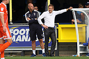 AFC Wimbledon manager Neal Ardley leaning on dug out during the EFL Sky Bet League 1 match between AFC Wimbledon and Shrewsbury Town at the Cherry Red Records Stadium, Kingston, England on 12 August 2017. Photo by Matthew Redman.