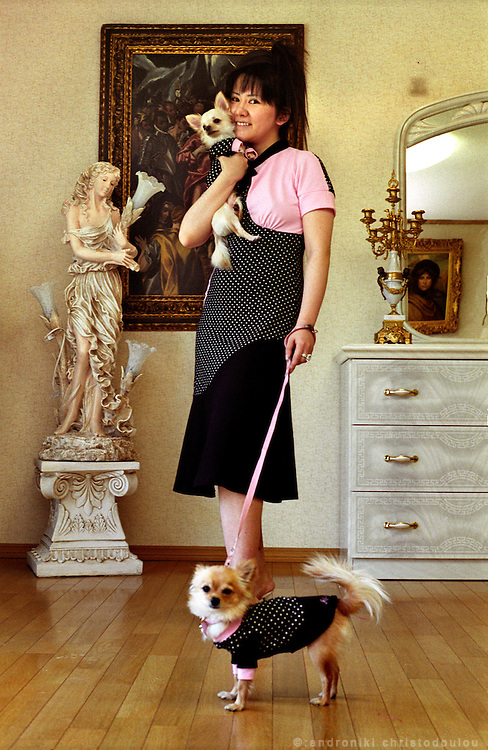 Shoko Mizuta with her dogs, wearing a matching dress with the dogs' clothes..Osaka April 2004