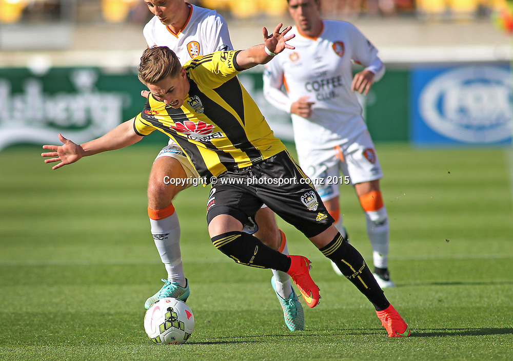 Phoenix' Tyler Boyd is dragged down in a tackle during the A-League football match between the Wellington Phoenix & Brisbane Roar at Westpac Stadium, Wellington. 4th January 2015. Photo.: Grant Down / www.photosport.co.nz