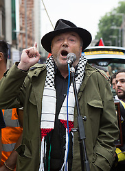 Image ©Licensed to i-Images Picture Agency. 11/07/2014. London, United Kingdom. Demonstration in London against Israeli strikes in Gaza. Central London. George Galloway addresses protesters  in a demonstration against Israeli strikes in Gaza outside the Israeli embassy in London. Picture by Daniel Leal-Olivas / i-Images