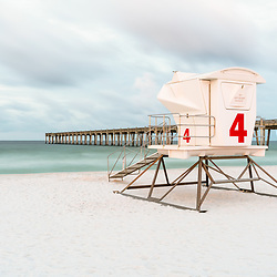 Pensacola Beach Pier and lifeguard tower four photo. Pensacola Beach is on Santa Rosa Island in the Southeastern United States of America. Copyright ⓒ 2018 Paul Velgos with All Rights Reserved.