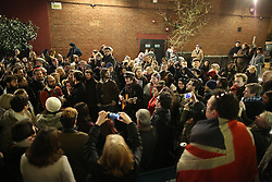 © Licensed to London News Pictures. 11/01/2016. A crowd sings David Bowie songs in the street in Brixton. The Death of David Bowie,  who was born in Brixton, was announced earlier today. Photo credit: Peter Macdiarmid/LNP