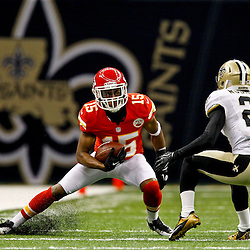 September 23, 2012; New Orleans, LA, USA; Kansas City Chiefs wide receiver Steve Breaston (15) is pursued by New Orleans Saints cornerback Patrick Robinson (21) during the fourth quarter of a game at the Mercedes-Benz Superdome. The Chiefs defeated the Saints 27-24 in overtime. Mandatory Credit: Derick E. Hingle-US PRESSWIRE