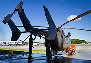 New Windsor, New York - Members of the U.S. Army Second Aviation Detachment clean a UH-72A Lakota helicopter at at Stewart Airport on Aug. 28, 2015. ©Tom Bushey / The Image Works