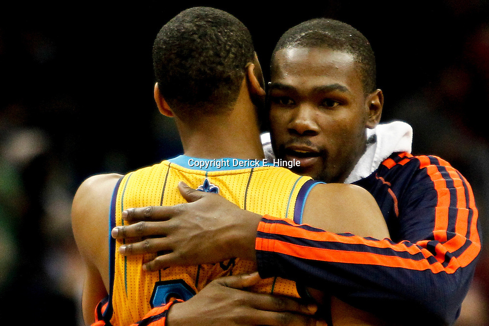November 16, 2012; New Orleans, LA, USA; Oklahoma City Thunder small forward Kevin Durant (35) and New Orleans Hornets power forward Anthony Davis (23) embrace following a game at the New Orleans Arena. The Thunder defeated the Hornets 110-95. Mandatory Credit: Derick E. Hingle-US PRESSWIRE