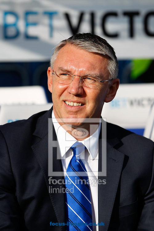 CORRECTED METADATA: Reading manager Nigel Adkins looks on during the Sky Bet Championship match at the Loftus Road Stadium, London<br /> Picture by Andrew Tobin/Focus Images Ltd +44 7710 761829<br /> 16/02/2014