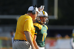 St. X head coach Will Wolford, left talks with kicker Owen Johnson during the first half. Henry Clay hosted St. Xavier at Lexington Catholic High School, Friday, Aug. 28, 2015 in Lexington.