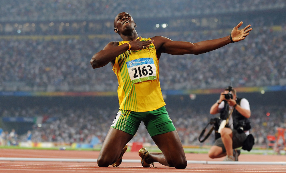 2008 OLYMPIC GAMES - TRACK- 082008 - Jamaica's Usain Bolt celebrates his win in the men's 200 meters, setting a world record of 19.30 in the process.
