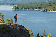 USA. Idaho, McCall. Hiker enjoying view of Payette Lake from Ponderosa Point a State Park. MR