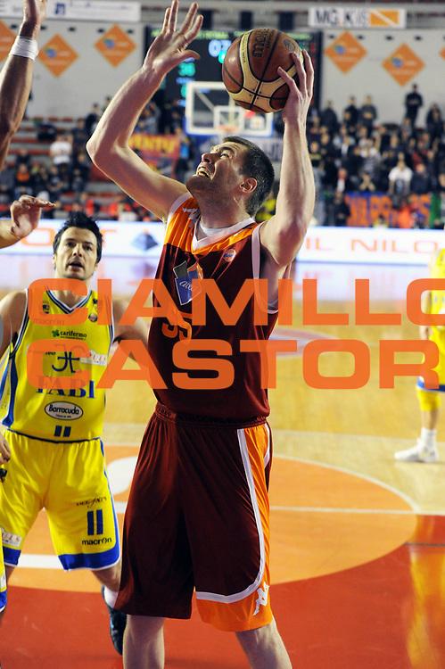 DESCRIZIONE : Roma Lega A 2011-2012 Acea Roma Fabi Shoes Montegranaro<br /> GIOCATORE : Uros Slokar<br /> CATEGORIA : tiro<br /> SQUADRA : Acea Roma<br /> EVENTO : Campionato Lega A 2011-2012<br /> GARA : Acea Roma Fabi Shoes Montegranaro<br /> DATA : 08/02/2012<br /> SPORT : Pallacanestro<br /> AUTORE : Agenzia Ciamillo-Castoria/GiulioCiamillo<br /> GALLERIA : Lega Basket A 2011-2012<br /> FOTONOTIZIA : Roma Lega A 2011-2012 Acea Roma Fabi Shoes Montegranaro<br /> PREDEFINITA :