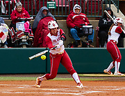 #20 Caleigh Clifton at bat and gain another hit to help the Sooners gain another victory against the Iowa State Cyclones on Sunday, April 08, 2018, at Marita Hynes Field.
