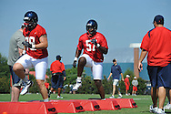 Ole Miss' Robert Conyers (78) and Terrell Brown (57) go through a drill as Ole Miss began football practice in Oxford, Miss. on Saturday, August 4, 2012.