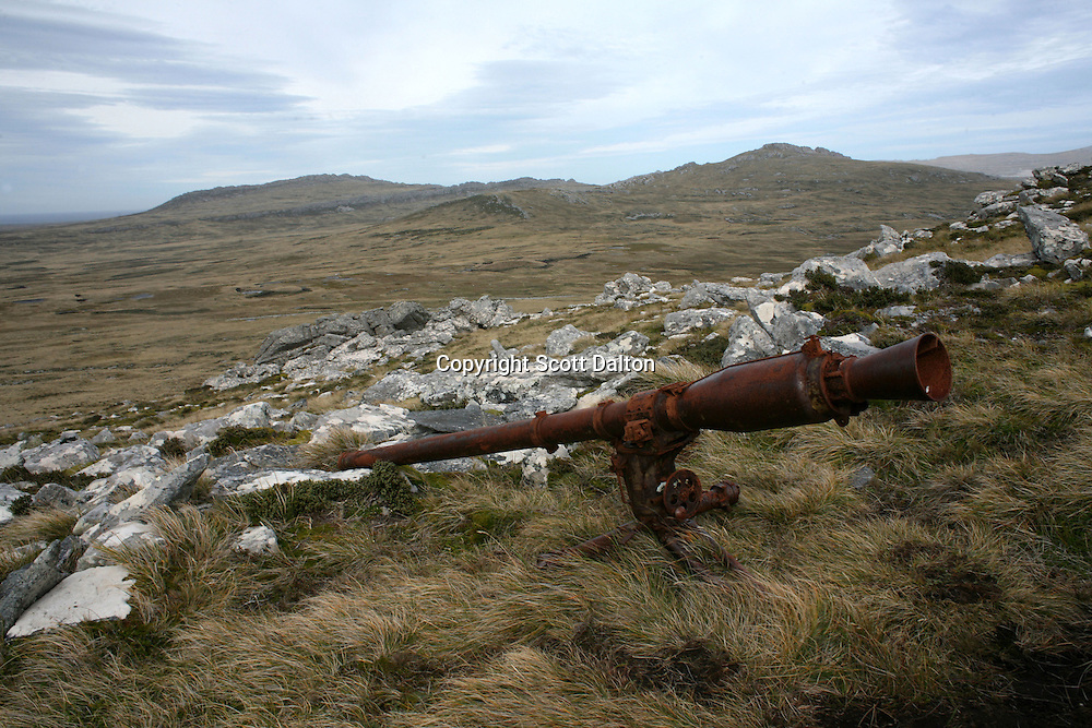 An abandoned gun left behind after the war lies on Mt. Longdon, where British and Argentinean forces clashed during the 1982 war over the Falkland Islands, just outside of Stanley, the capital of the Falkland Islands, on Sunday, March 18, 2007. (Photo/Scott Dalton)