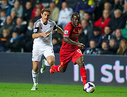 6.09.2013, Liberty Stadion, Swansea, ENG, Premier League, Swansea City vs FC Liverpool, 4. Runde, im Bild Liverpool's Victor Moses in action against Swansea City during the English Premier League 4th round match between Swansea City AFC and Liverpool FC at the Liberty Stadium, Swansea, Great Britain on 2013/09/16. EXPA Pictures © 2013, PhotoCredit: EXPA/ Propagandaphoto/ David Rawcliffe<br /> <br /> ***** ATTENTION - OUT OF ENG, GBR, UK *****