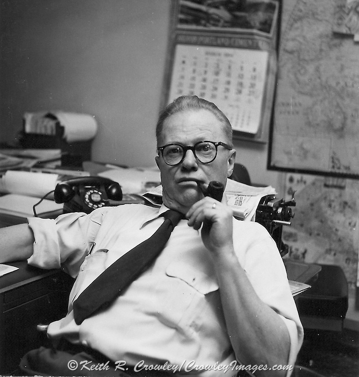 Gordon MacQuarrie at his desk in the Milwaukee Journal editorial offices, ca. 1950.