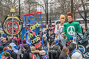 "A CND led national demonstration to protest against Britain's nuclear weapons system: Trident. They state - ""The majority of the British people, including the Labour leader Jeremy Corbyn, oppose nuclear weapons. They are weapons of mass destruction, they don't keep us safe and they divert resources from essential spending."" The march from Hyde park to Trafalgar Square was supported by Friends of the Earth, the Green party, Greenpeace, the PCS Union, the Quakers, the Stop the War Coalition, War on Want amongst amny others."