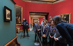 One of the most iconic paintings in the world, which has never before been seen in Scotland, begins a flying visit to Edinburgh this week. The Goldfinch, a beautiful and mysterious masterpiece from the Golden Age of Dutch art, which was painted by Carel Fabritius in 1654, will be on loan to the Scottish National Gallery for six weeks from 4 November to 18 December.<br /> <br /> Pictured: Young people from The Chorister School, County Durham and Emilie Gordenker, Director of the Royal Picture Gallery Mauritshuis, The Hague