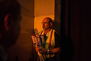 A convention worker holds a bundle of American flags at the Democratic National Convention on Wednesday, September 5, 2012 in Charlotte, NC.