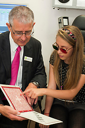At the opening of his new Optometrists in Preston on Saturday  Mike Broadhurst gives Lauren Powell a spatial awareness test to demonstrate the importance of eye checks for children. ..18 August 2012.Image © Paul David Drabble
