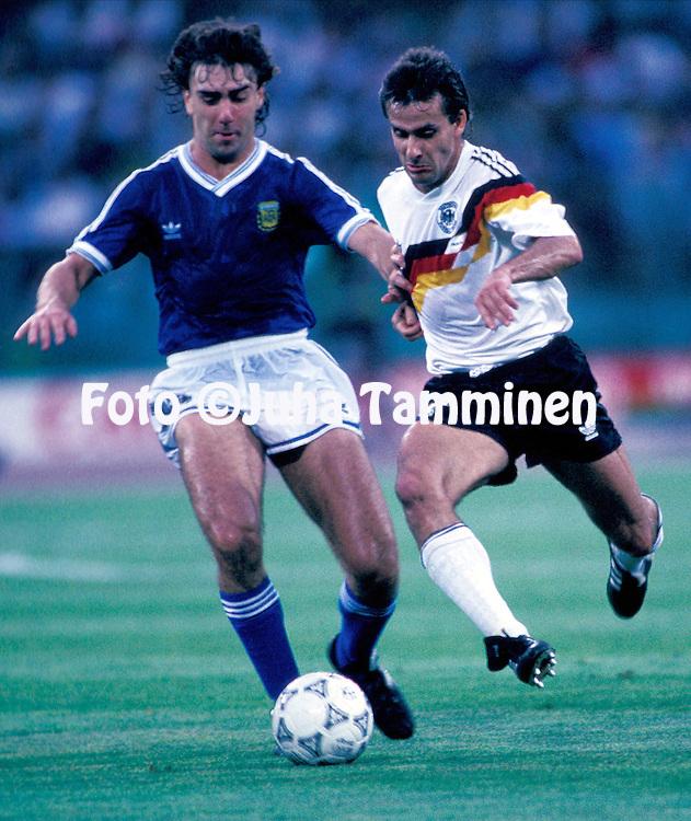 FIFA World Cup - Italia 1990<br /> Stadio Olimpico, Rome, Italy.<br /> Final Argentina v West Germany.<br /> Pierre Littbarski (Germany) v Nestor Lorenzo (Argentina).
