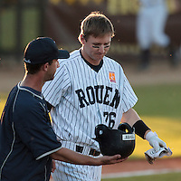 05 June 2010: Pascal Osmont of Rouen talks to Aaron Hornostaj during the 2010 Baseball European Cup match won 10-0 by Fortitudo Bologna over the Rouen Huskies, at the AVG Arena, in Brno, Czech Republic.