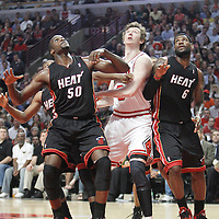 14 March 2012: Chicago Bulls center Omer Asik (3) vies for the rebound with Miami Heat center Joel Anthony (50) and Miami Heat small forward LeBron James (6) during the Chicago Bulls 106-102 victory over the Miami Heat at the United Center, Chicago, Illinois, USA.