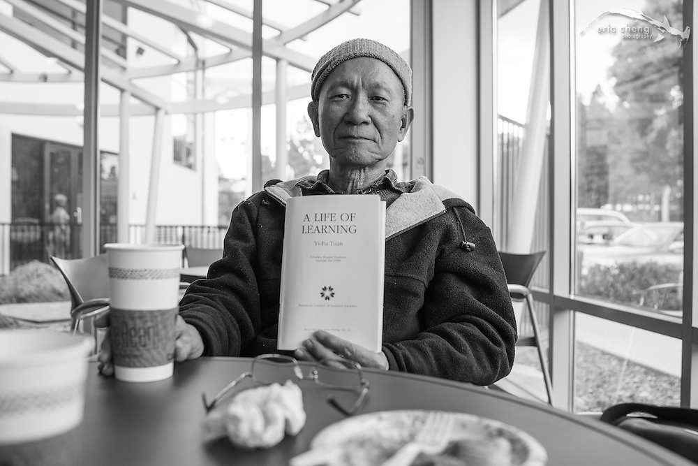 "May 8, 2013, 10:11am. Dad is reading ""A Life of Learning"" by Yi-Fu Tuan. At the JCC on break between appointments. San Diego, California."