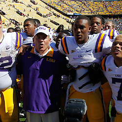 October 1, 2011; Baton Rouge, LA, USA;  LSU Tigers head coach Les Miles and players offensive tackle Alex Hurst (72), quarterback Jordan Jefferson (9) and cornerback Tyrann Mathieu (7) following a win over the Kentucky Wildcats at Tiger Stadium. LSU defeated Kentucky 35-7. Mandatory Credit: Derick E. Hingle-US PRESSWIRE / © Derick E. Hingle 2011