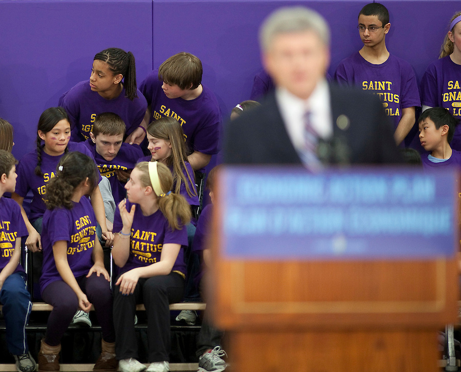 A student faints while listening to a speech by Prime Minister Stephen Harper at St. Ignatius of Loyola School in Guelph Ontario, Friday, March 11, 2011 where he announced funding for teaching science in schools.<br /> THE CANADIAN PRESS/ Geoff Robins