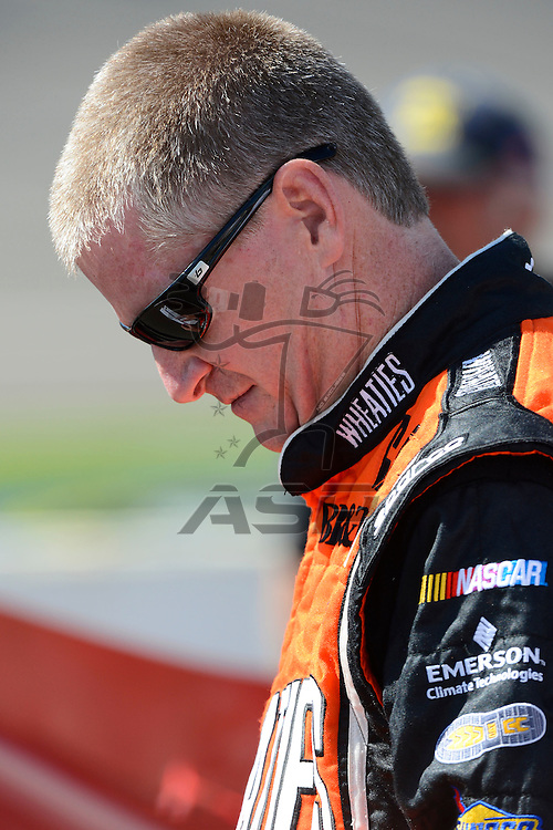 Brooklyn, MI  - Aug 17, 2012: Jeff Burton (31) stands on pit row during qualifying for the Pure Michigan 400 at Michigan International Speedway in Brooklyn, MI.