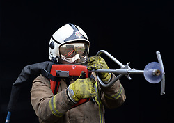 Pictured: Watch Manager Paul Halliday with the new firefighting lance.<br /> <br /> The Scottish Fire & Rescue Service unveiled it's latest weapon in firefighting, an ultra high pressure lance that allows firefighters to put out  fires more quickly using less water, and without having to enter the building. It is part of a £7.6 million GBP investment in 40 new smaller fire appliances that will enter service over the coming months, and will primarily be stationed in rural communities.<br /> <br /> © Dave Johnston/ EEm