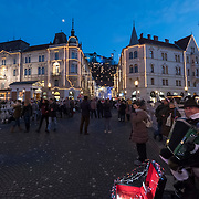 LJUBLJANA, SLOVENIA - DECEMBER 02: An accordian player entertains passers by on Triple Bridge on December 2, 2017 in Ljubljana, Slovenia. The traditional Christmas market and lights will stay until 1st week of January 2018.  (Photo by Marco Secchi/Getty Images)
