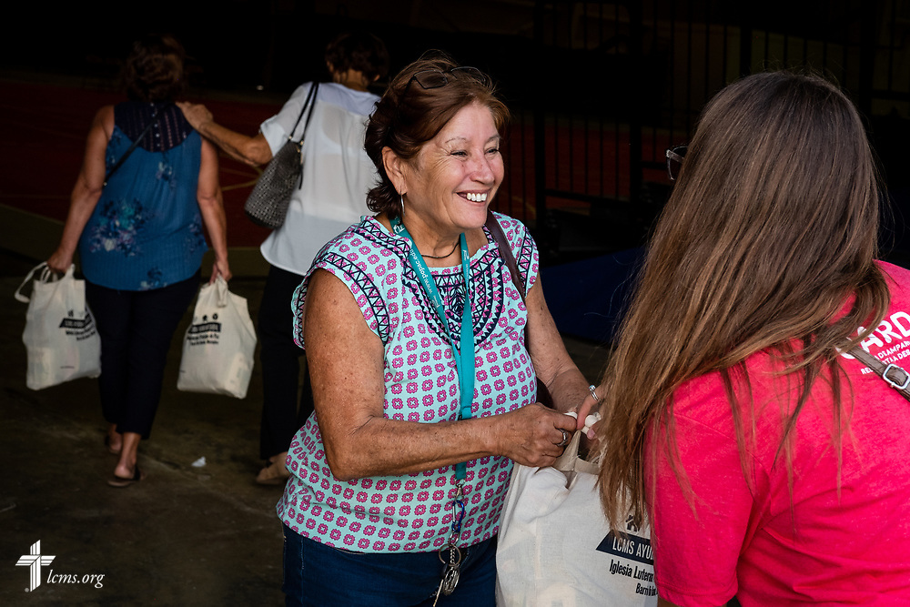 A community resident smiles at Natalie Howard, an LCMS GEO missionary serving the Dominican Republic, during a food distribution event at a local community center on Tuesday, April 17, 2018 in Mayagüez, Puerto Rico. LCMS Communications/Erik M. Lunsford