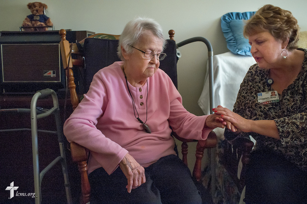 Chaplain Amy Upchurch prays with 92 year-old Lutheran Nelle Rolf at her home at Lutheran Senior Services, Rose Hill House, on Tuesday, Jan. 13, 2015, in Kirkwood, Mo. LCMS Communications/Erik M. Lunsford