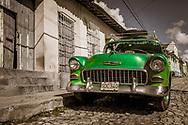 Cuban 1950s green car on street in Trinidad, Cuba