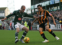 Photo: Lee Earle.<br /> Plymouth Argyle v Hull City. Coca Cola Championship. 09/12/2006. Hull's Craig Fagan (R) battles with Marcel Seip.
