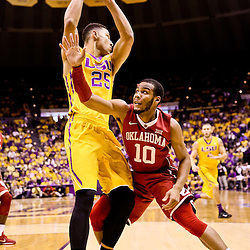 Jan 30, 2016; Baton Rouge, LA, USA; Oklahoma Sooners guard Jordan Woodard (10) defends LSU Tigers forward Ben Simmons (25) during the first half of a game at the Pete Maravich Assembly Center. Mandatory Credit: Derick E. Hingle-USA TODAY Sports