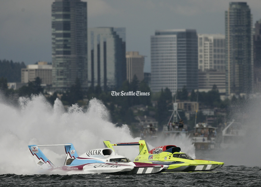 Dave Villwock, of Auburn, driving the Spirit of Qatar, passes Brian Perkins, of Black Diamond, in the Miss Peters &amp; May boat, before finishing second at the Albert Lee Cup at Seafair in Seattle on Sunday, August 8, 2010.<br />